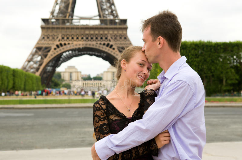 Happy couple in love in Paris royalty free stock image