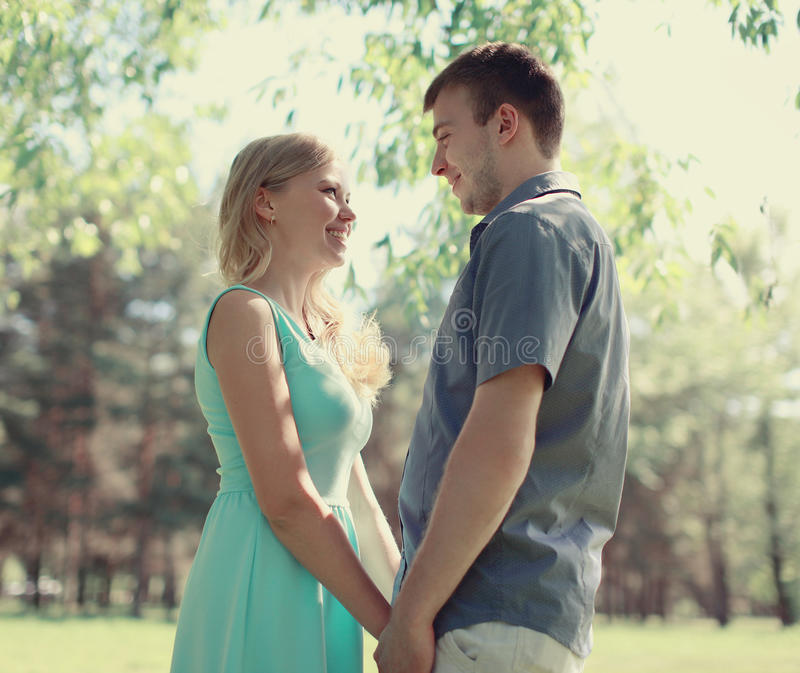 Happy couple in love. Sunny spring day stock image