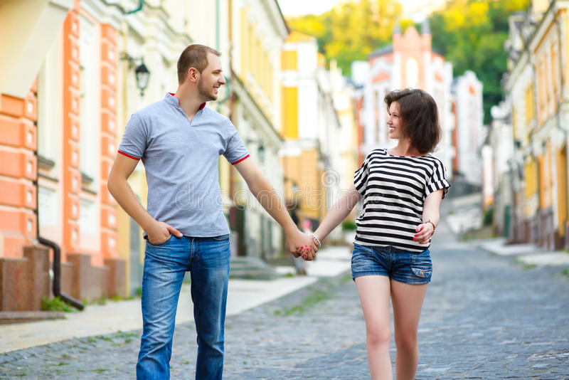 Happy couple in love walking at city.  royalty free stock image