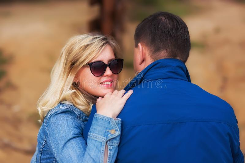 Relationship concept. Happy couple in love at yellow and green summer park. royalty free stock photos