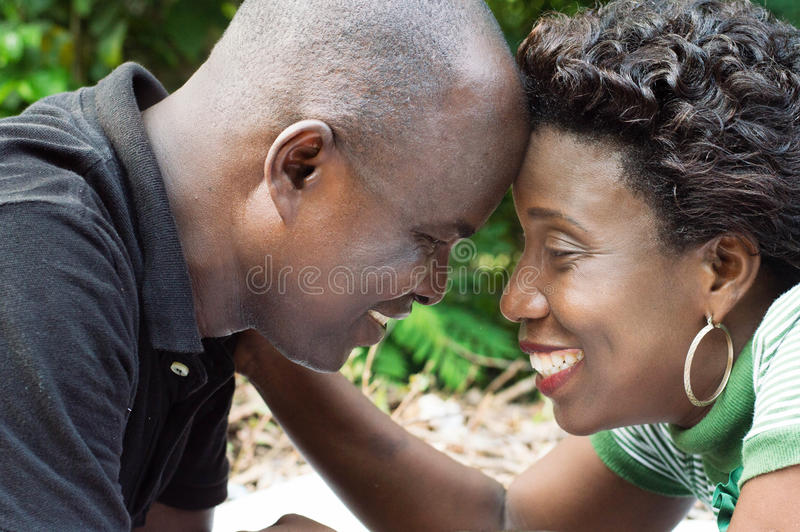 Download Happy Couple Lying Forehead Against Forehead Stock Photo - Image: 83721722