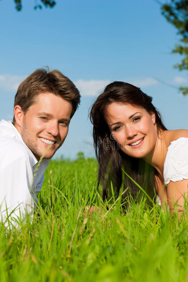 Download Happy Couple Lying On A Meadow Stock Image - Image: 22403247