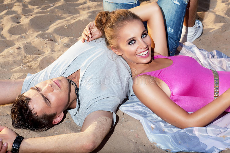 Download Happy Couple Lying Together On Sand - Romance Stock Image - Image: 26819489