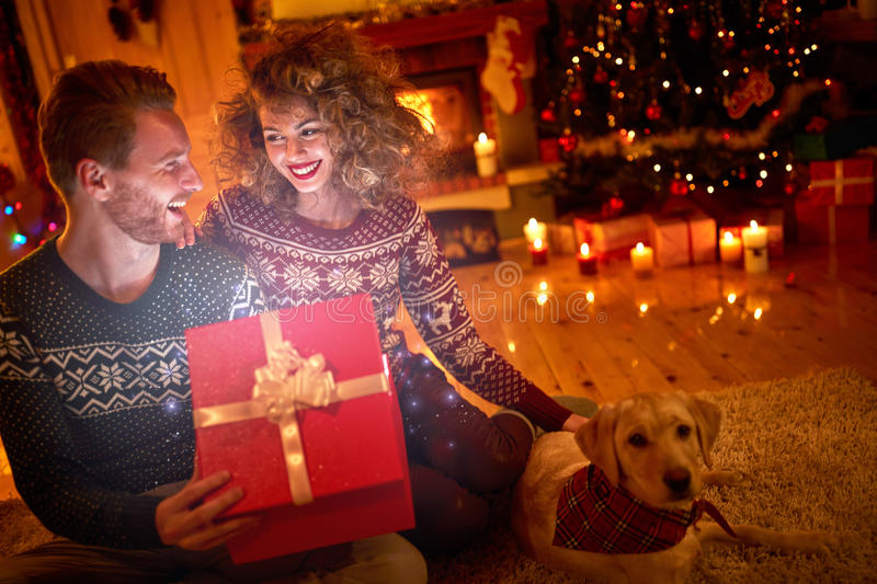 Happy couple with magical gift royalty free stock images