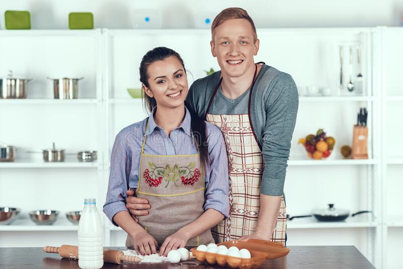 Happy Couple Making Domestic Pastry at Kitchen. stock photos
