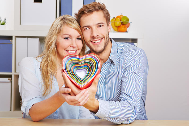 Happy Couple With Many Hearts Stock Photography