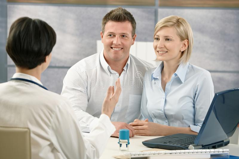 Happy Couple At Medical Appointment Stock Image