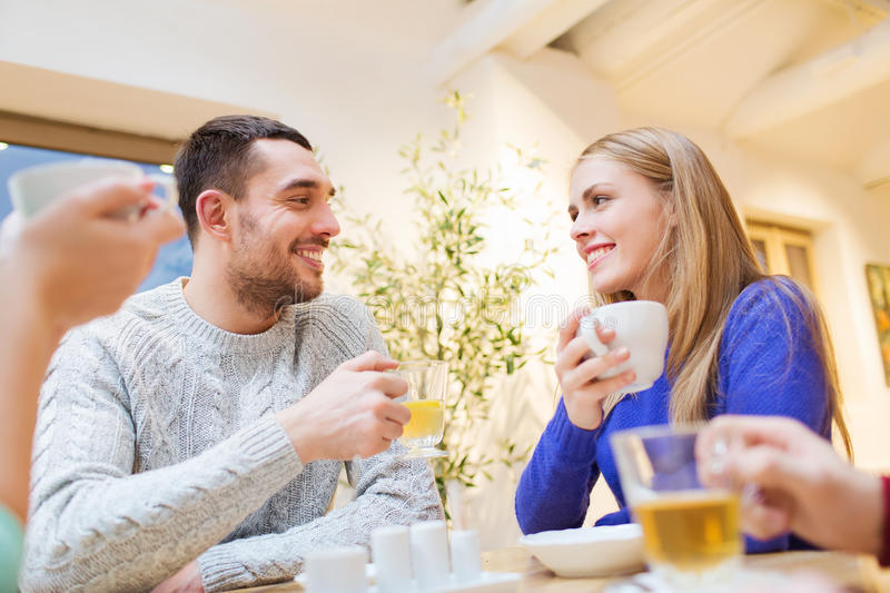 Happy couple meeting and drinking tea or coffee stock photos