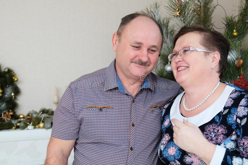 Happy couple middle age, smiling and laughing portrait stock photo