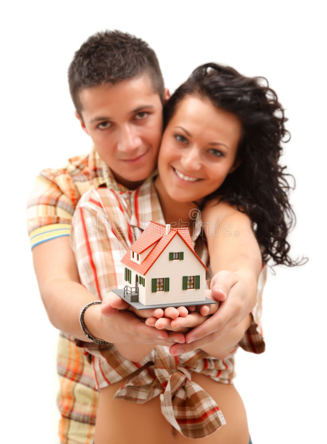 Happy couple with miniature house stock photos