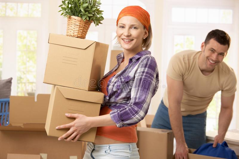 Happy couple moving house stock photo