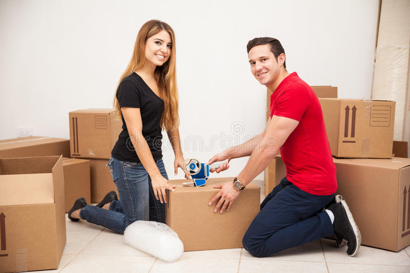 Happy couple moving out stock photography