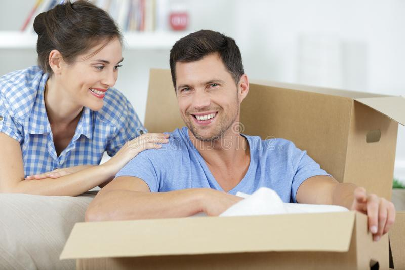 Happy couple in new home. Man royalty free stock photos