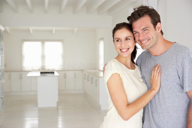 Happy couple in new home. Smiling off camera royalty free stock photos