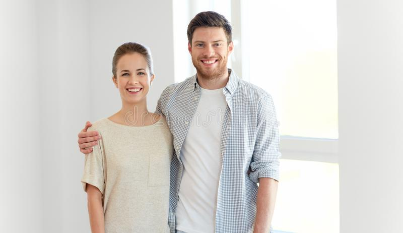 Happy couple at new home. Mortgage, people and real estate concept - happy couple at new home stock images