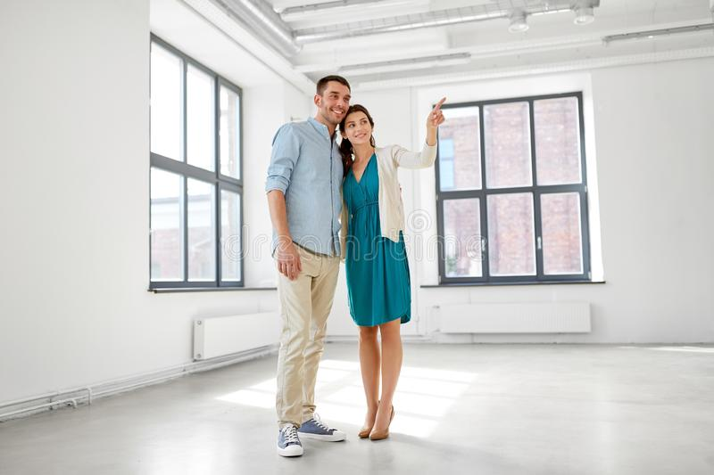 Happy couple at new home. Mortgage, people and real estate concept - happy couple at new home royalty free stock photo