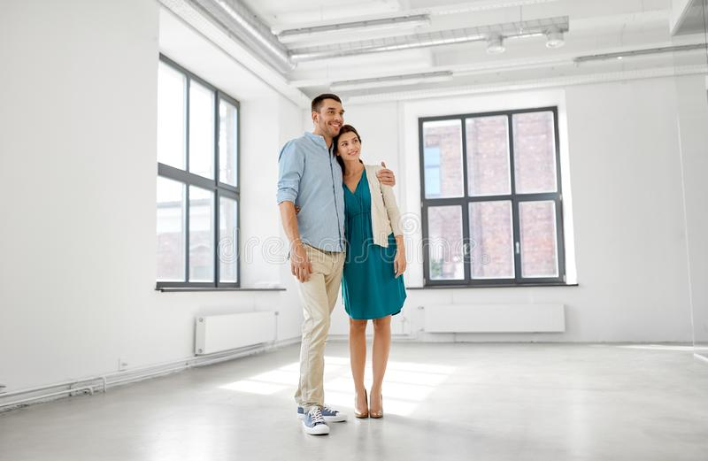 Happy couple at new home. Mortgage, people and real estate concept - happy couple at new home royalty free stock images