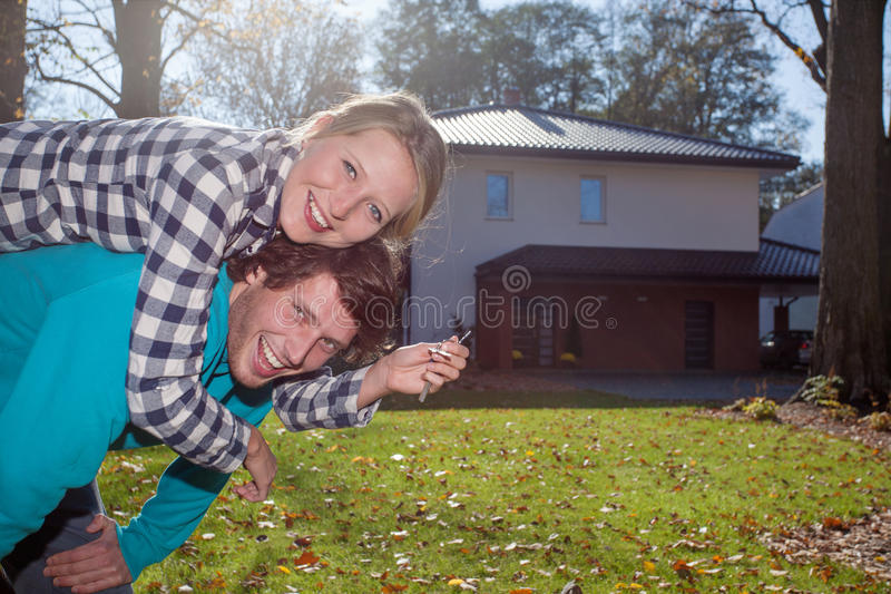 Happy couple with a new house stock photography