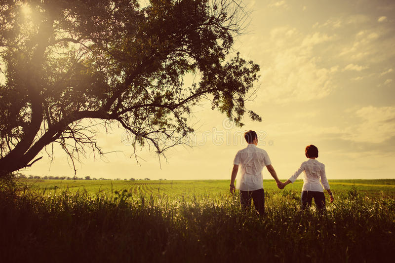 Happy couple outdoor, summertime royalty free stock images