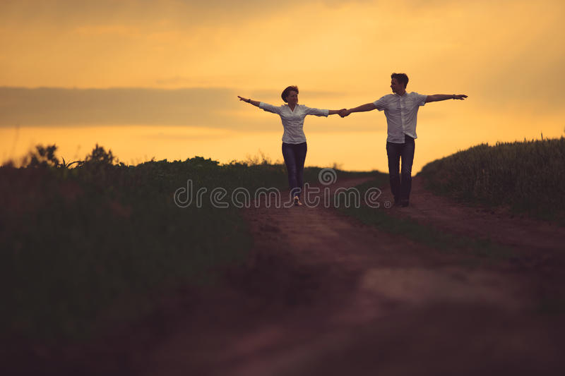 Happy couple outdoor, summertime royalty free stock photography
