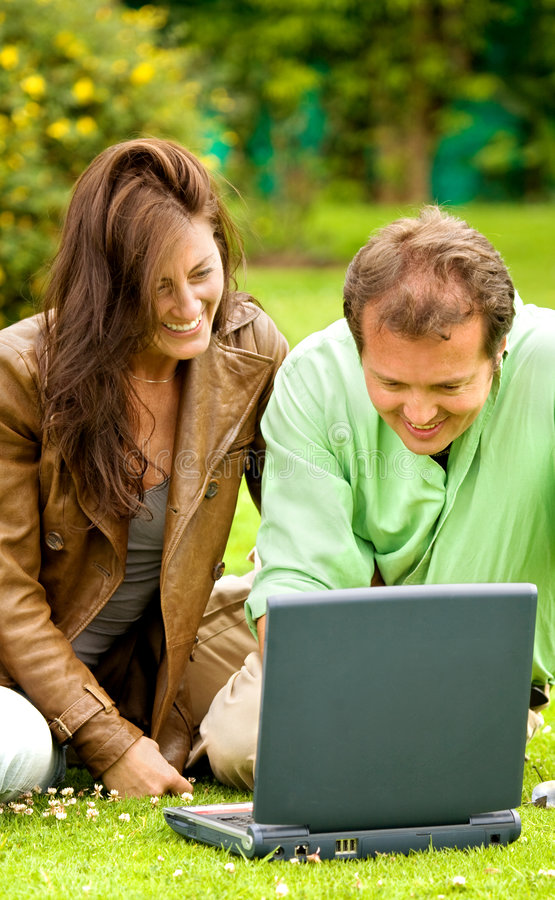 Download Happy couple outdoors stock photo. Image of girl, laptop - 3229738