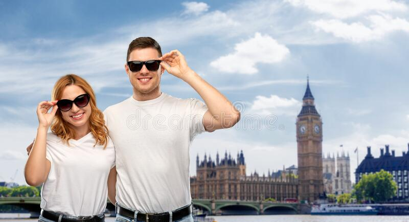 Happy couple over big ben tower in city of london royalty free stock photography