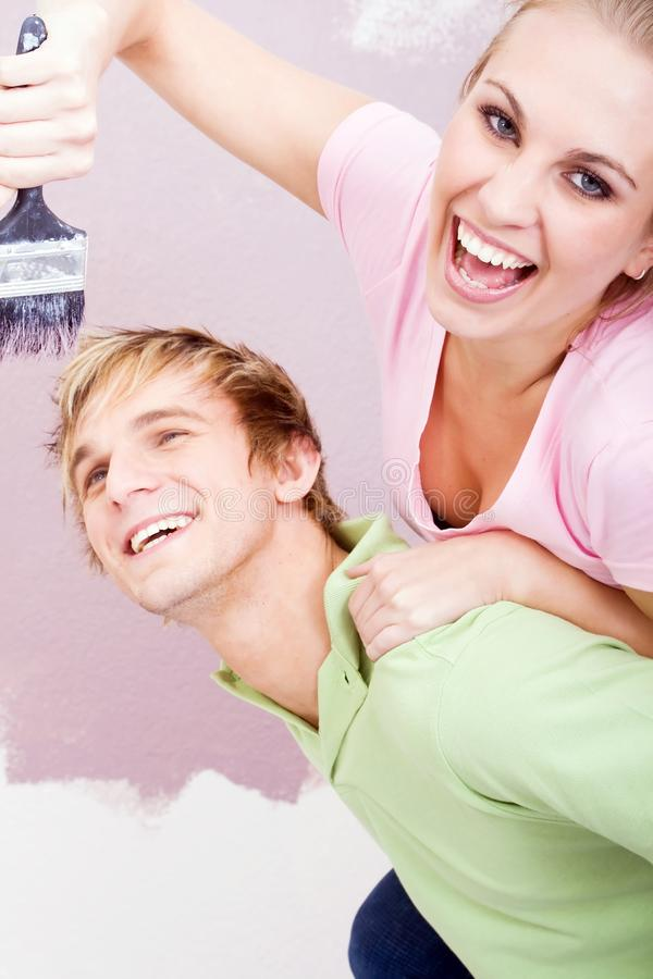 Happy couple painting royalty free stock photos