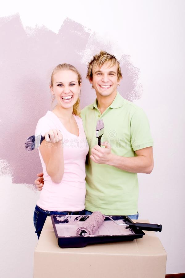 Happy couple painting stock photo