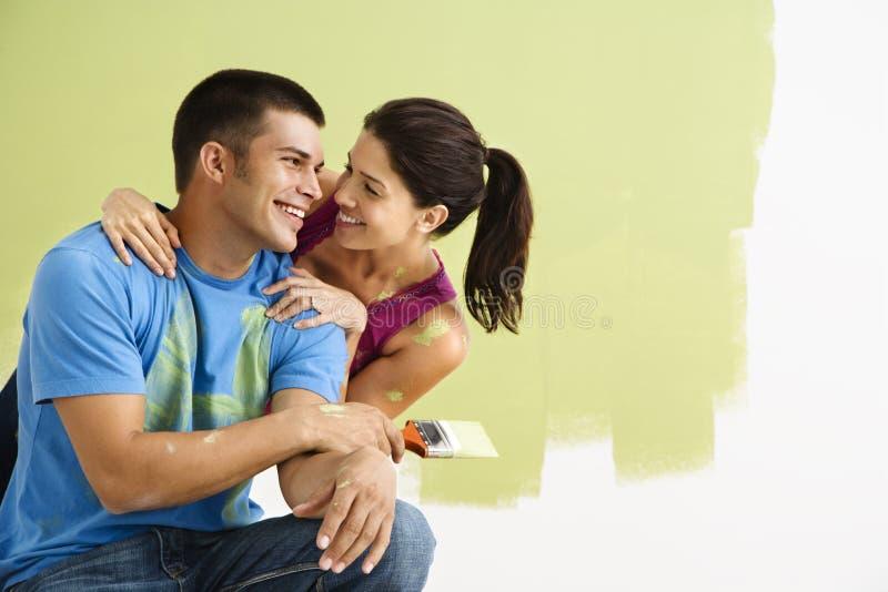 Happy couple painting. stock image