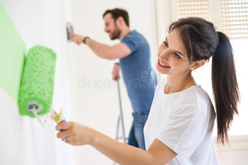 Smiling loving couple doing home renovations together stock image