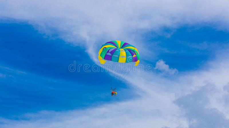 Happy couple Parasailing in Cancun beach in summer. Mexico royalty free stock photo