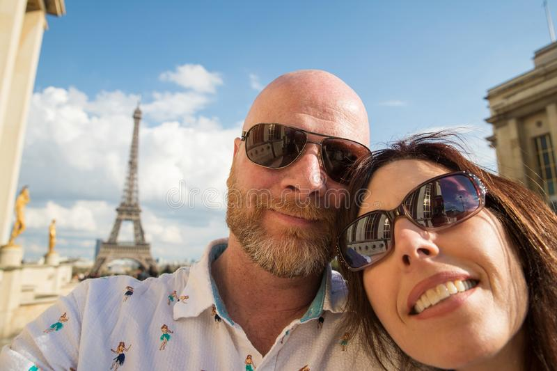 Happy couple in Paris, France. Happy Couple Takes a selfie near the Eiffel Tower in Paris, France stock images
