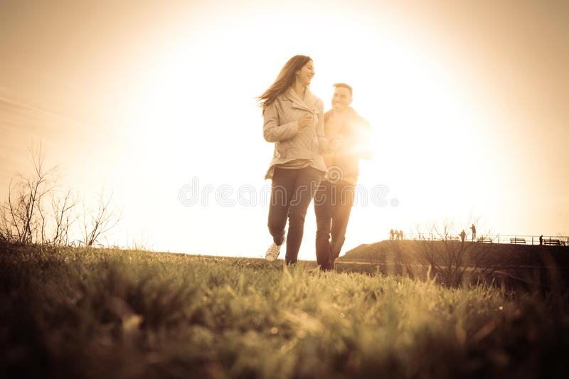 Happy couple in the park. Happy couple running trough park. Space for copy. royalty free stock photography