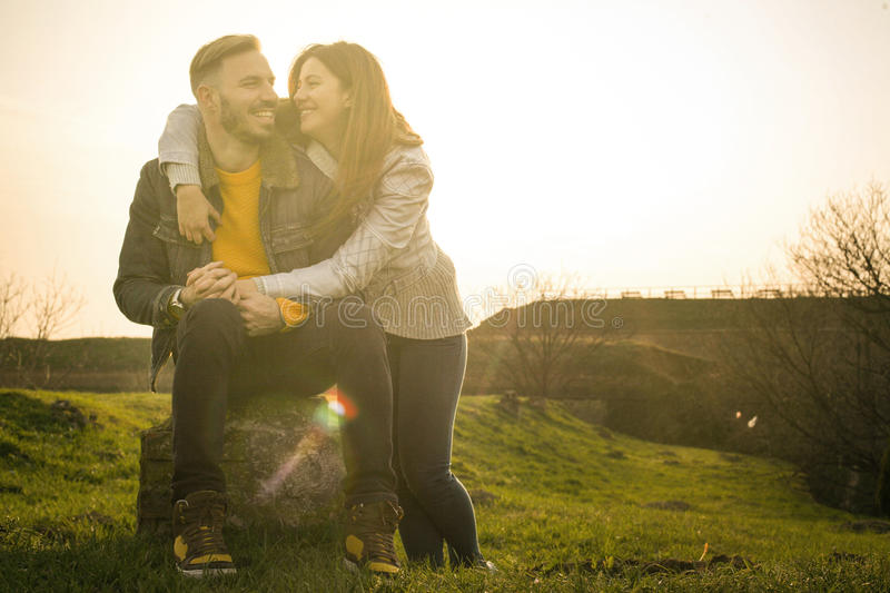 Happy couple in the park. stock image