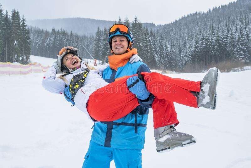 Happy couple people have fun and enjoy the fresh snow in winter mountains Carpathians.  royalty free stock photo