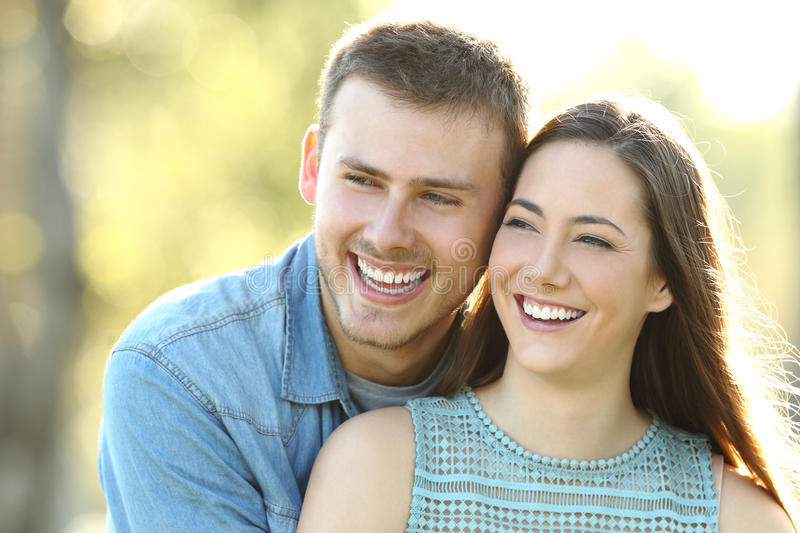 Happy couple with perfect smile looking at side royalty free stock image