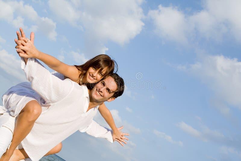 Happy couple piggyback royalty free stock images