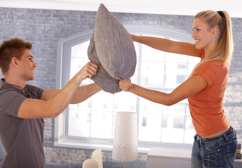 Download Happy Couple In Pillow Fight Stock Image - Image: 23992977