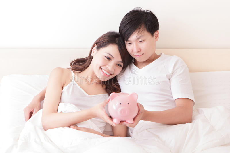 Download Happy Couple With Pink Piggy Bank Stock Image - Image: 32901643