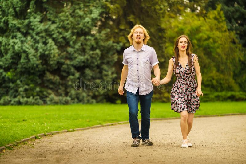 Happy couple playing in park stock images