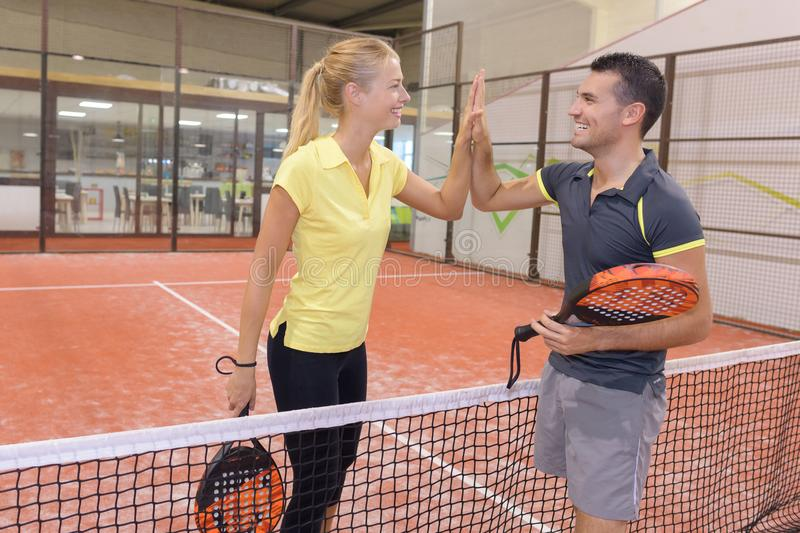 Happy couple playing tennis indoor tennis court royalty free stock image