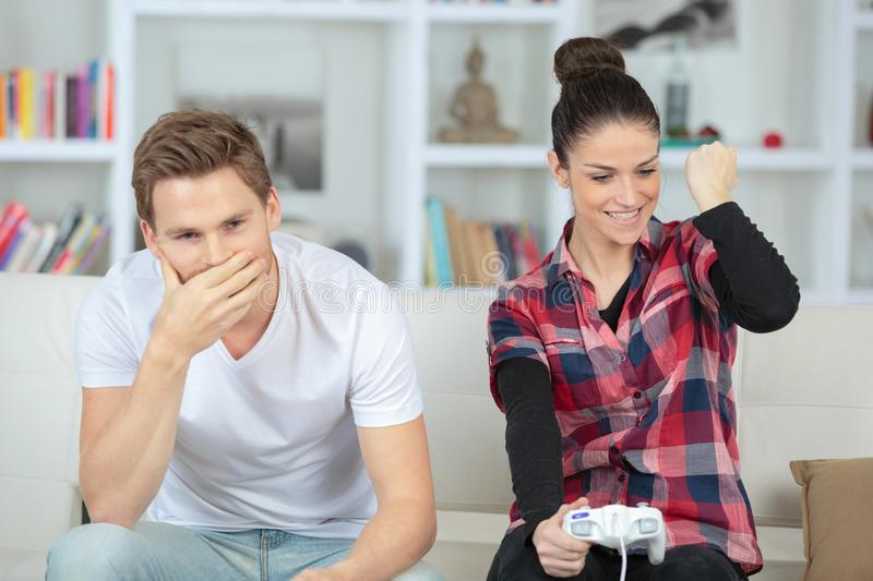 Happy couple playing video games royalty free stock image