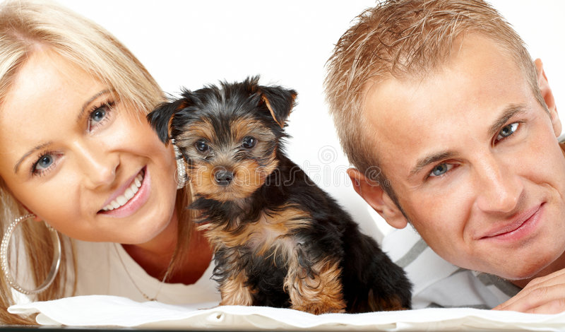 Happy couple with a puppy stock image