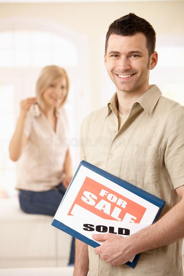 Happy couple purchasing new house stock photos