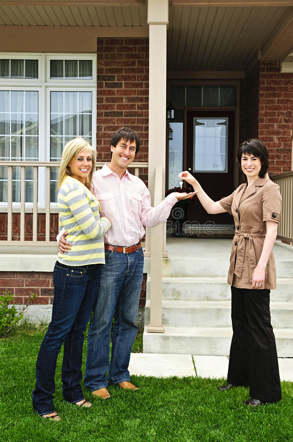 Happy couple with real estate agent royalty free stock image