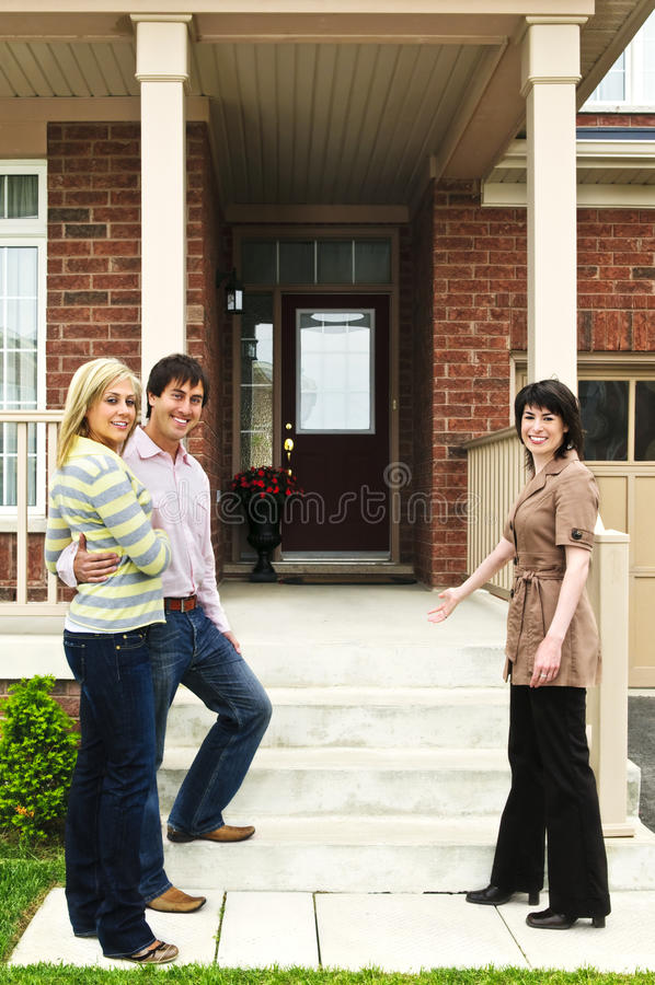 Happy couple with real estate agent royalty free stock photography