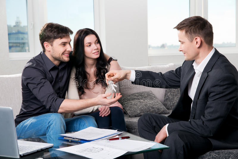 Happy couple with real estate agent royalty free stock images