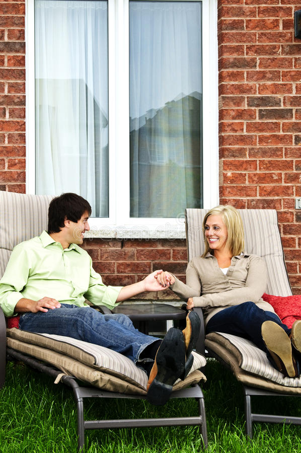 Happy couple relaxing at home stock images