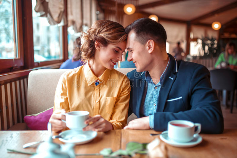 Happy couple, romantic date in restaurant. Man and women beautiful relationship stock photo