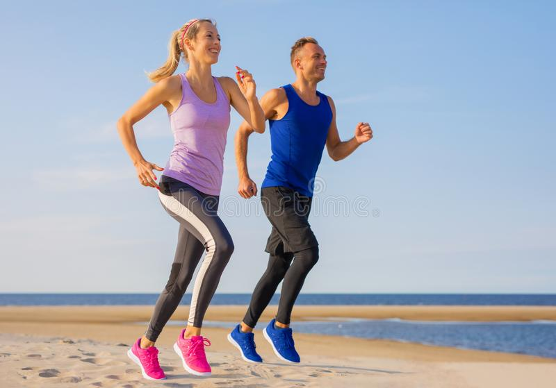 Happy and fit couple running royalty free stock images